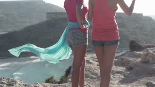 Female friends in vantage point and enjoy the view, slow motion shot at 240fps