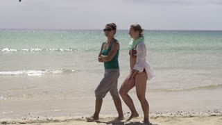 Female friends walking on the beach, slow motion shot at 240fps