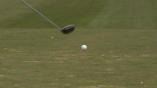 Female Golfer Tees Off In Slow Motion