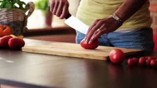 Female hands with knife, cutting fresh red tomatoes, steadicam shot