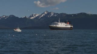 Ferry And Fishing Ship By Mountains