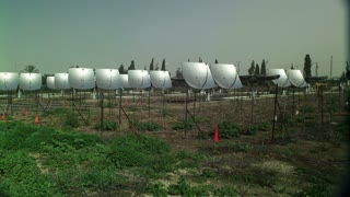 Field Of Solar Pannels That look Like Satellite Dishes