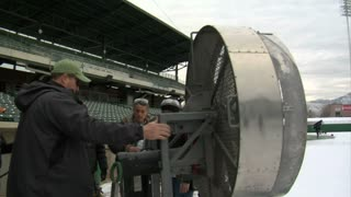 Film Crew Adjusts Fan On Outdoor Movie Set