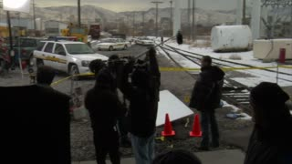 Film Crew Films Crime Scene By Tracks In Winter