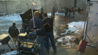 Film Crew Monitoring Scene On Set