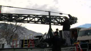 Film Crew Operates Large Crane On Movie Set