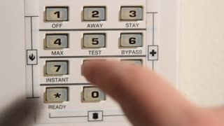Finger Pushing Buttons On Home Security System 2