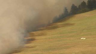 Firetruck Backs Down Road Toward Fire