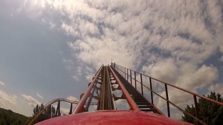 First Climb Up Roller Coaster in Theme Park