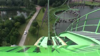 First Drop on Green and Purple Roller Coaster