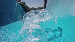 First-person view, the descent from the waterslide on holiday aqua park