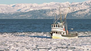 Fishing Boat Approaching Icy Harbor