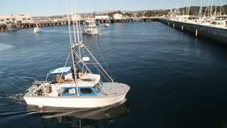 Fishing Boat Returns To Harbor In Monterey California