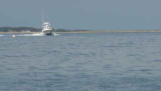 Fishing Boat Speeding Through Bay Waters 1