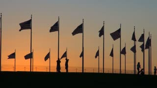 Flags at Washington Monument Waving at Sunset