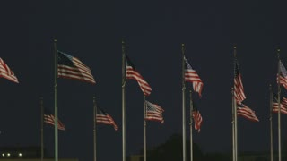 flags waving in the middle of the night