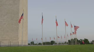 flags waving in the wind, George Washington monument, Washington DC