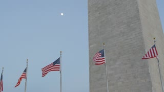 flags with moon in front of national monument