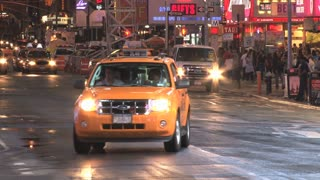 Fleet of Taxis Driving on New York Street