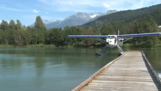 Floating Plane By Scenic Mountains