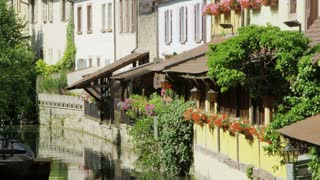 Flowers And Houses Along Canal in Colmar, France