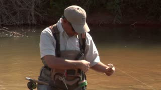 Fly Fisherman Changes Fly With Toolkit