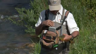 Fly Fisherman Displays Large Trout
