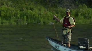 Fly Fisherman Drift Boat Casts In Slow-motion