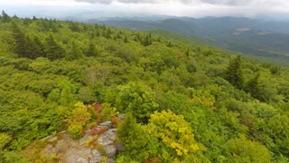 Flying backwards over rocks and trees in Appalachian Mountains
