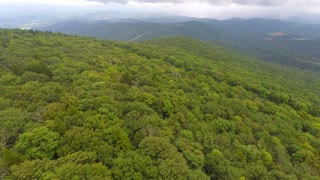 Flying backwards over trees in Appalachian Mountains