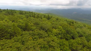 Flying forward left over trees in Appalachian Mountains