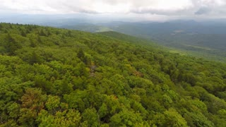 Flying forward over trees in Appalachian Mountains