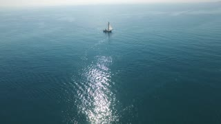 Flying Over A Sailing Boat In The Open Sea