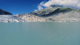 flying over melting ice floe. glacier lake panorama. mountain alps
