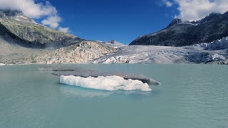 flying over melting ice floe on glacier lake. climate change background