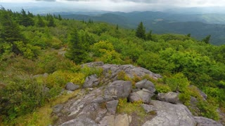 Flying over rocks and trees in Appalachian Mountains 2