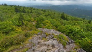 Flying over rocks and trees in Appalachian Mountains