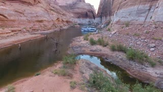 Flying through canyons and over a houseboat in Lake Powell Utah
