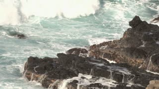 Foamy Water Crashes onto Rocks