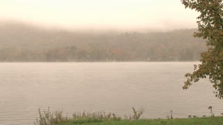 Fog And Low Clouds Over Lake