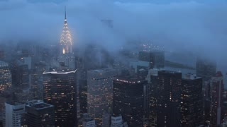 fog over new york city skyline time lapse
