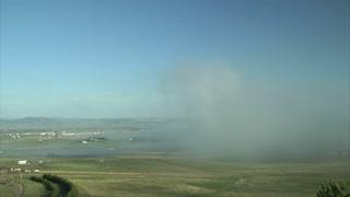 Fog Sweeping Over Farmland
