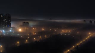 Foggy City Night Time-Lapse 1. Timelapse shot of a city late at night blanketed in fog.