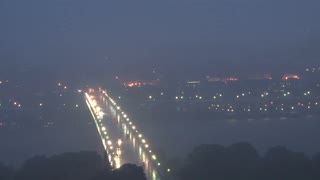 Foggy Rain Over City and Bridge at Dusk