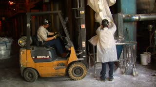 Forklift And Workers In Chemical Plant
