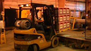 Forklift Loads Pallet