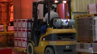 Forklift Moves Pallets Of Boxes