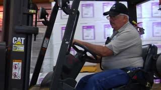 Forklift Operator Drives Forklift