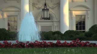 Fountain Surrounded By Flowers in White House Front Yard