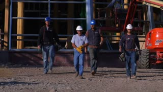 Four Construction Workers Walked Toward Camera